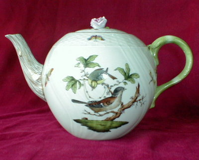 A Herend Rothschild large bird teapot, featuring two different bird motifs (there are 12 Rothschild Oiseaux motifs) and scattered butterflies, circa 1915-1930.
