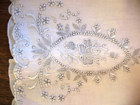 Delicate, five-pedal flowers are characteristic of Appenzell embroidery.