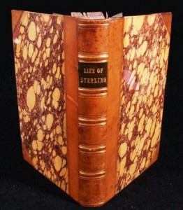 A half bound book with marbled covers.