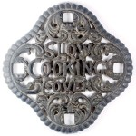 "Stove Trivet: ""Slow Cooking Cover,"" 7"" diameter, late 1800s; value $45"