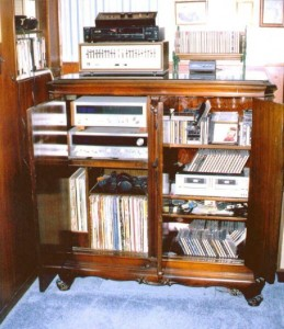 With a little work and no damage to the cabinet, it can be fitted to hold audio equipment; its original intended use.