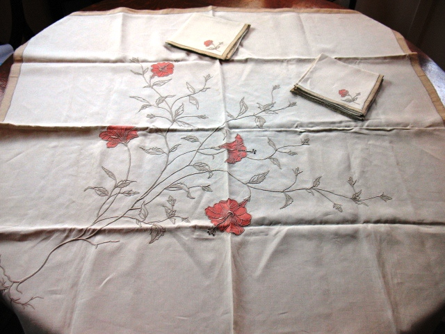 A tablecloth with matching napkins in the Hibiscus pattern. Some tablecloths had 100,000 stiches.