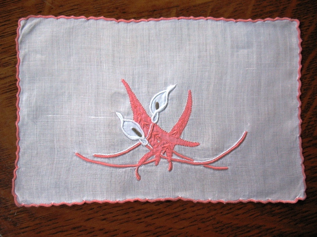 A Marghab Linen cocktail napkin with the Calla Lilly design.
