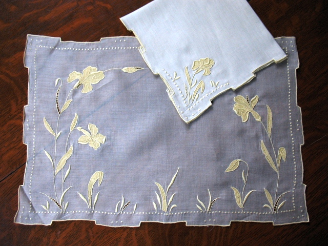 Yellow and white Margandie and linen placemat and napkin in the Iris design.