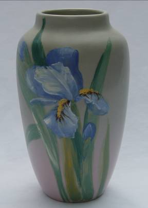 Chips on the top rim of this Weller Art Pottery vase were professionally restored by Old World Restorations, Inc., Cincinnati, Ohio.