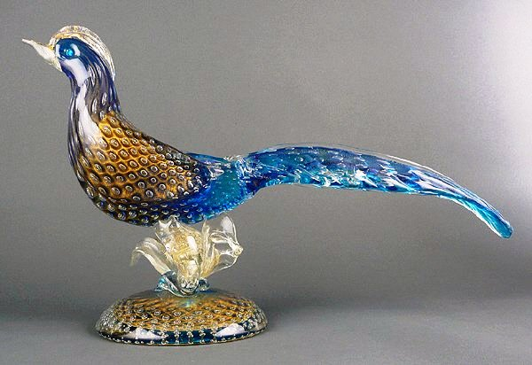 This Venetian Murano pheasant (circa 1960) measures 19 inches long and stands about 10 inches tall. Comparable examples by unknown artists sel in the $150 to $300 range.