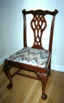 This is a reproduction of a Chippendale chair, circa 1940. Chippendale has been continuously copied through the years to the point where they are not indicative of age