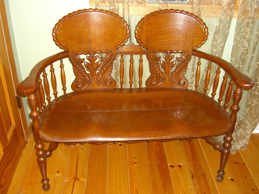 This oak bench was made by Charles Stickley of Stickley-Brandt around the turn of the 20th century.