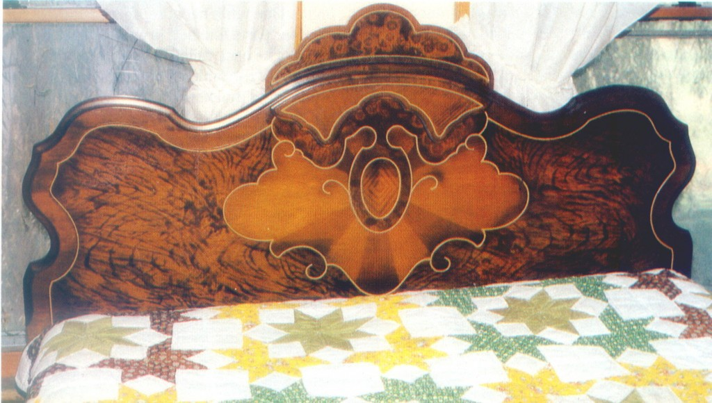 This showy 1920's headboard is in excellent condition. But its quality is so poor that it has little real value. (Swedberg photo)