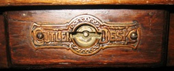 The Cutler Desk Co. of Buffalo used this escutcheon plate for its label.