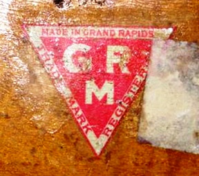 "This mark was used by members of the Furniture Manufacturers Association of Grand Rapids between 1899 and 1913 to identify true ""Grand Rapids Made"" furniture and to differentiate it from imposters of the period."
