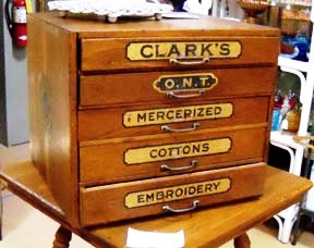 "In 1866, when George Clark developed a thread that was strong enough to be used in the newly invented mechanical sewing machine, he didn't have a name for it. He simply called it ""Our New Thread"" and the initials ""ONT"" became a staple on thread cabinets after that."