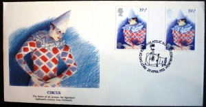 """Printers of cachet envelopes don't always get their facts right. In 1982 England issued a set of four stamps of the British Theatre. This stamp was titled Harlequin. The printer of the envelope decided to turn the Harlequin into Joseph """"Joey"""" Grimaldi (1778-1837) even though the image on the envelope looks nothing like known images of Grimaldi. The real Grimaldi was English and is thought to have been the first whiteface clown. Today the word """"Joey"""" is circus lingo for clown."""
