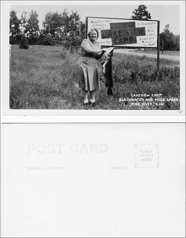 This RPPC of a bobby sox-clad woman, holding up the big fish she caught, touts Lakeview Camp in Pine River, Minn. Note the typical white handwritten caption. The back, from a different card, carries a DOPS stamp box. A bit of research shows that DOPS photographic paper was used in the late 1930s-1940s.