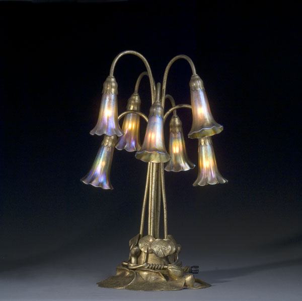 This Tiffany Seven-Light Lily Lamp with Gold Dore Base is one of the most innovative styles of the Tiffany lamps. Originally selling for $80 100 years ago, it sold for $21,850 (including the buyer's premium).