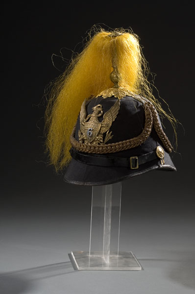 This 1881 pattern cavalry officer's dress spiked helmet has a planchet with an eagle and a banner in his beak that reads E. Pluribus Unum. Crossed swords and patriotic shield with German silver 6 surmounted on shield with arrows in left talon and olive twig in right talon. Complete with orange dyed horsehair plume, this helmet sold for $977.50 in 2006. (Photo courtesy of Cowan's Auctions, Inc., Cincinnati, Ohio)