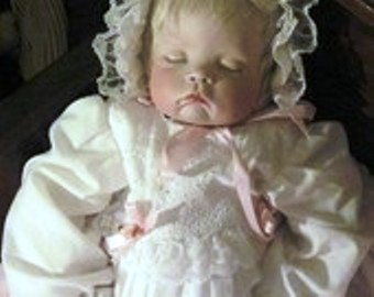 The sleeping baby doll. I never felt comfortable with this doll and eventually needed to put it in storage out in the barn.