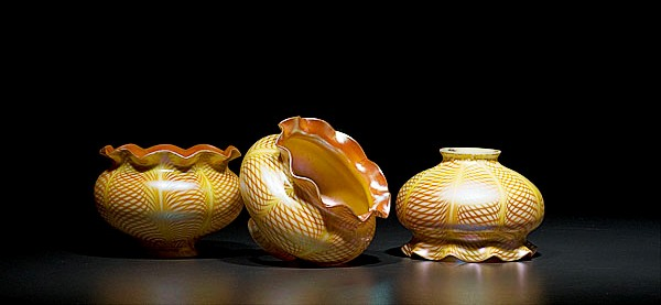 Three Steuben ovoid pulled lace pattern shades sold for $1,495 at auction.