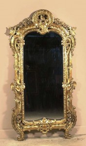 This elaborate frame was not carved at all. It is made of plaster that was poured into a mold. Of course, the mold had to be carved at some point but only once. (LiveAuctioneers.com/Northgate Gallery photo)