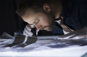 Levi Bettweiser looks over negatives developed from discarded rolls of old film.