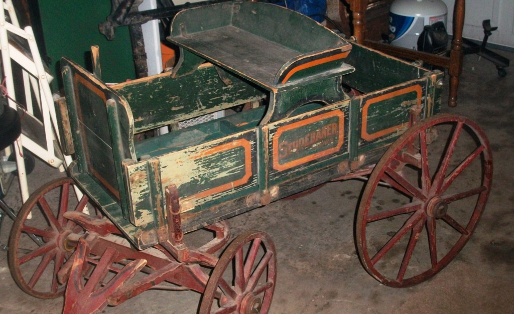 This Studebaker Junior Wagon, in need of restoration with chipped, peeling and worn paint some age cracks in the wood, is still a relatively rare find and worth $500 to $600.