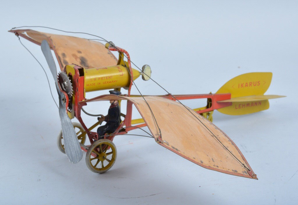 This rare German-made Lehmann Ikarus flying toy is is all original and complete with its original paper wings! Showing very little wear and beautiful coloring with working windup works, this toy is estimated to bring $1000 t0 $1,500.