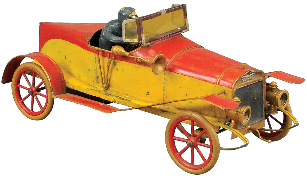 This Hispano-Suiza Alfonso XIII Racer, circa 1914, is a tin race painted in a red and yellow color scheme featuring a working clockwork motor, foldable windshield, opening door and rubber tires, appointments include cast headlamps, grips, horn and driver. Measuring more than 13 inches long, it is expected to sell for $4,000 to $5,000.