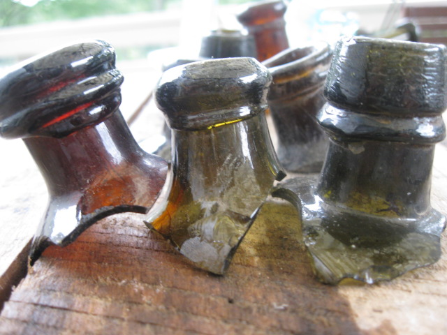 These cork-topped bottles were manufactured prior to 1875 or thereabouts. If you look closely, you can see that the collar-style lip was applied as a separate piece of glass.