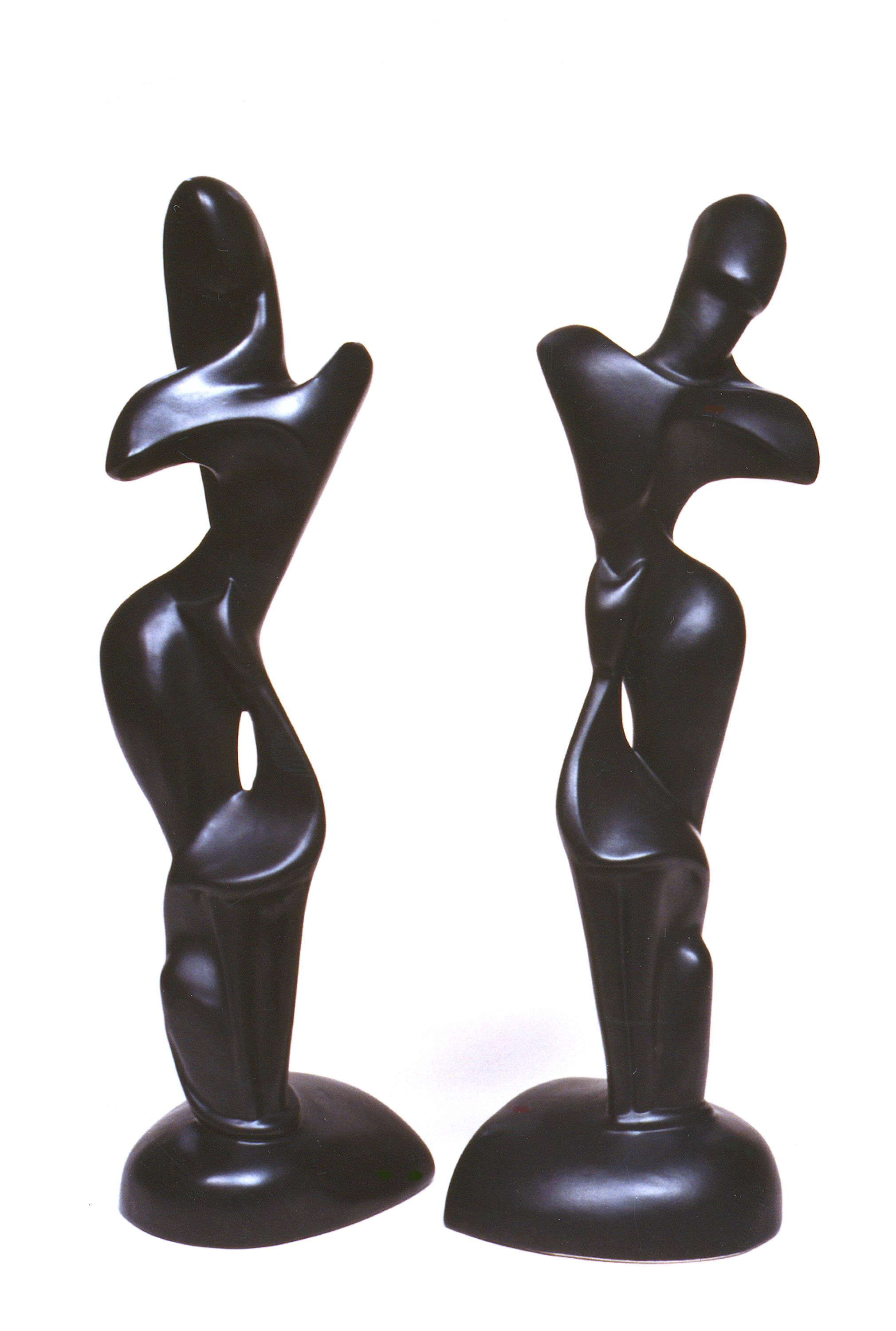 These black-glazed male & female abstract figures measure 21 inches in height. They are the work of Jean Yves Mock, a Brayton designer of the 1950s.