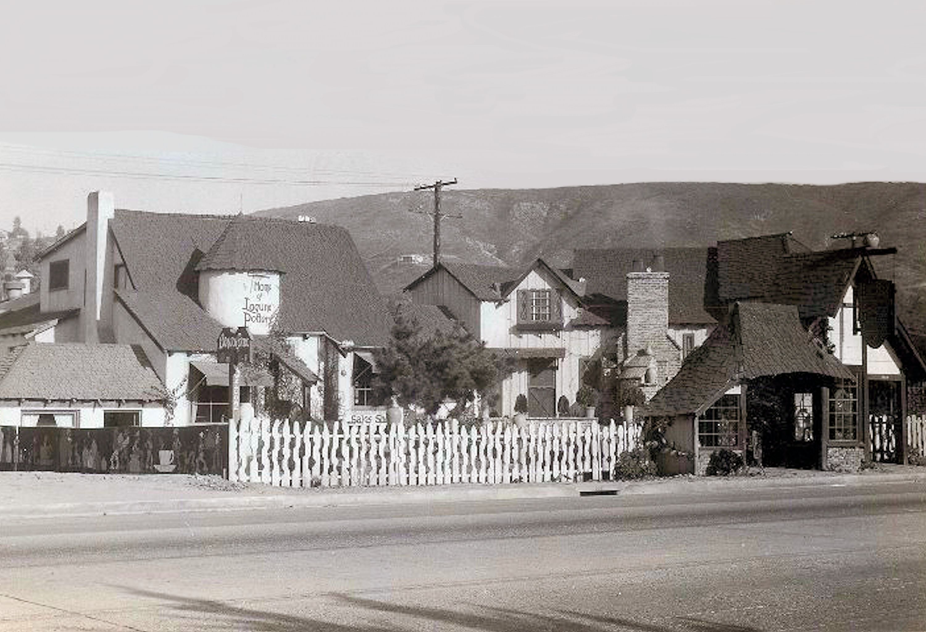 A postcard view of the expanded Brayton Laguna Pottery on Pacific Coast Highway in Laguna Beach. Some of the original Swedish style buildings still stand today.