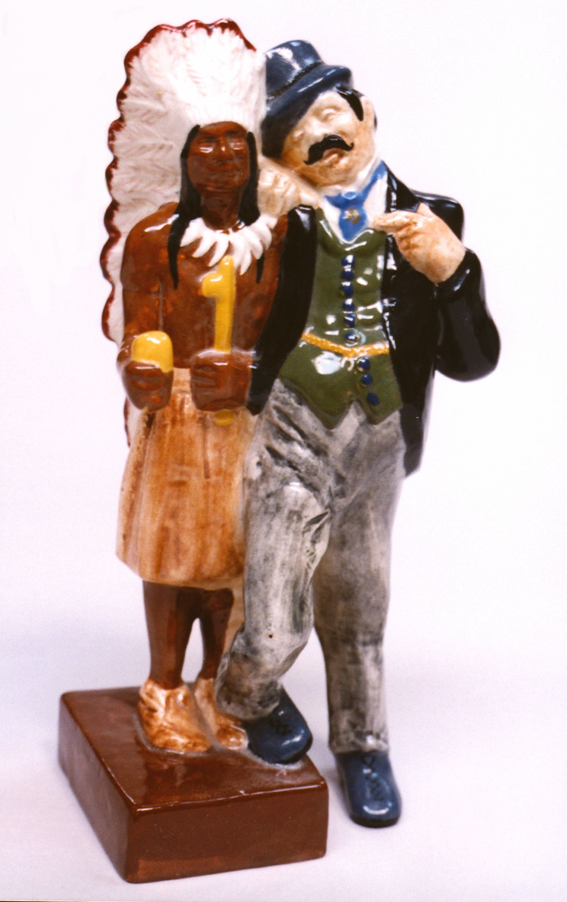 From the Gay Nineties series of figurines the 1940s, this 9 ½-inch man in period attire posing with a cigar store Indian is one of its harder-to-find items.