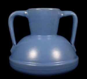 A handled vase glazed in Catalina blue over brown island clay.