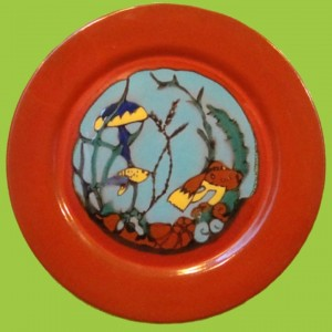 "A decorative ""Submarine Garden"" plate produced by Catalina Clay Products on the island of Santa Catalina in the 1930s. These were made in more than one size and border color and are very popular and pricey with collectors."