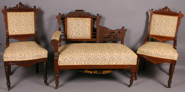 This Eastlake style three-piece set, circa 1890, with shallow ship carving has an unusual variation for the couch. (LiveAuctioneers.com/Kaminski Auctions photo)