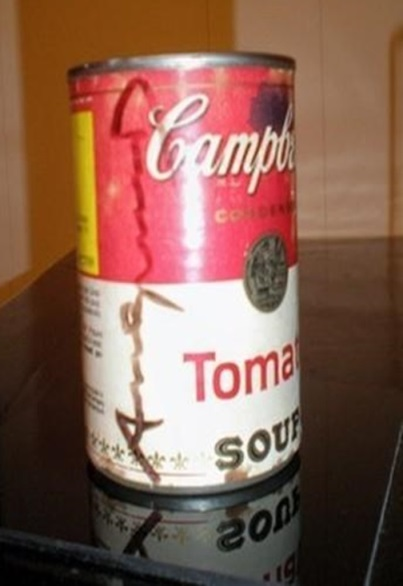 Despite the fading and staining of the label, this Campbell's Soup can with Warhol's autograph on it sold for $1,575 on eBay in 2013.