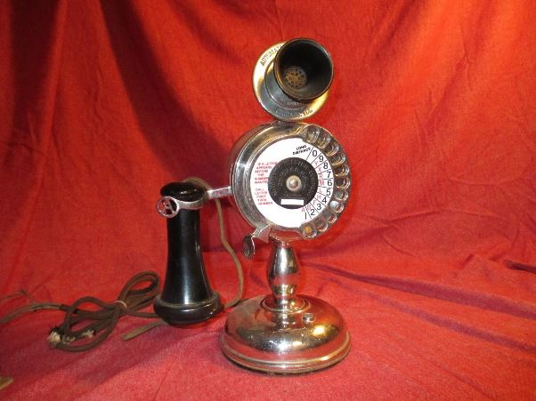 The sales description for this 1905 Strowger Pot-Belly candlestick phone says that it is all original with a replaced number card, the original cord and connector and a Bakelite-over-metal finish and mouthpiece. It can be yours for $4,500.