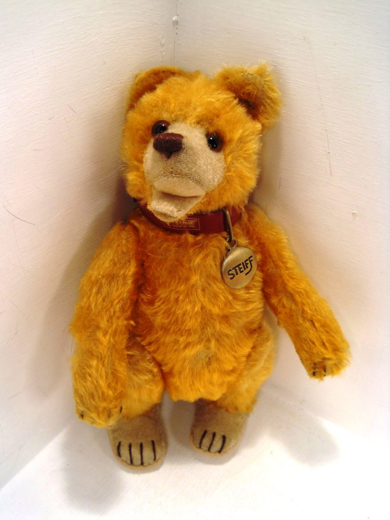 This early post-World War Two mohair Steiff Teddy Baby doesn't have any personal history or significant financial value, but his brilliant color and unusual arrangement of Steiff IDs make him quite rare. As a result, I had him cleaned, his felt foot paw pads recovered and his nose restitiched by a professional restorer.
