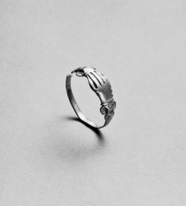 european ring with clasped right hands