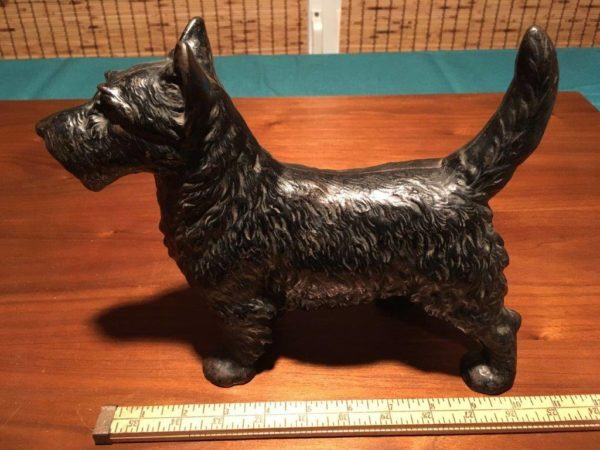 RINKER ON COLLECTIBLES: A Scottie Doorstop, a Murphy Chair, a Cookie Jar, and a Pop-up Book